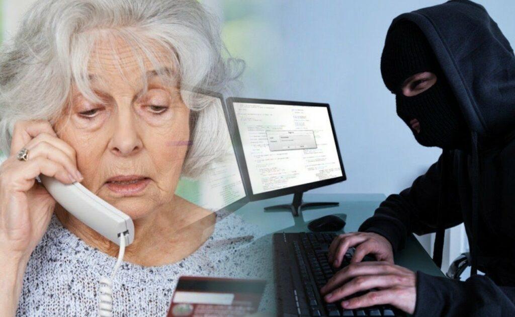 На фото мошенник разговаривает по телефону с женщиной пенсионеркой для совершения мошеннических действий с кредитной картой банка.